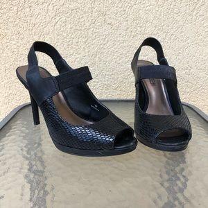 Black snakeskin-embossed slingback heels